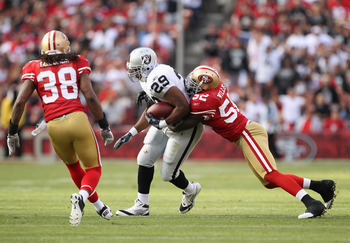 SAN FRANCISCO, CA - AUGUST 20:  Michael Bush #29 of the Oakland Raiders is tackled by Patrick Willis #52 of the San Francisco 49ers at Candlestick Park on August 20, 2011 in San Francisco, California.  (Photo by Ezra Shaw/Getty Images)