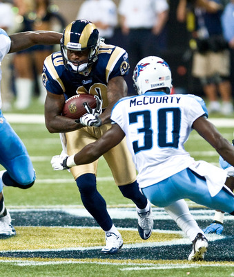 ST.LOUIS, MO - AUGUST 20: Mike Sims-Walker #10 of the St. Louis Rams catches a pass and is tackled by Jason McCourty #30 of the Tennessee Titans during a pre-season game at the Edward Jones Dome on August 20, 2011 in St.Louis, Missouri.  (Photo by Ed Szcz