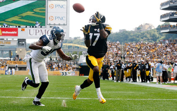 PITTSBURGH - SEPTEMBER 18:  Mike Wallace #17 of the Pittsburgh Steelers catches a touchdown pass in front of Brandon Browner #39 of the Seattle Seahawks in the second half during the game on September 18, 2011 at Heinz Field in Pittsburgh, Pennsylvania.