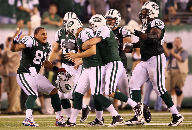 EAST RUTHERFORD, NJ - SEPTEMBER 11:  Nick Folk #2 of the New York Jets celebrates with teammates Dustin Keller #81, Mark Brunell #8 and Brandon Moore #65 of the New York Jets after FOlk kicked a successful 50-yard game-winning field goal against the Dalla