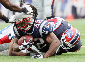 FOXBORO, MA - SEPTEMBER 26:  BenJarvus Green-Ellis #42 of the New England Patriots is brought down by Donte Whitner #20 of the Buffalo Bills during on September 26, 2010 at Gillette Stadium in Foxboro, Massachusetts. The Patriots defeated the Bills 38-30.