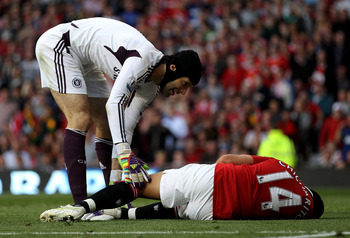 MANCHESTER, ENGLAND - SEPTEMBER 18:  Javier Hernandez of Manchester United lies injured on the pitch following a tackle by Ashley Cole of Chelsea during the Barclays Premier League match between Manchester United and Chelsea at Old Trafford on September 1