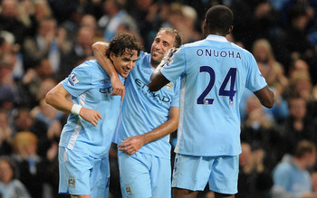 MANCHESTER, ENGLAND - SEPTEMBER 21:  Owen Hargreaves of Manchester City celebrates scoring to make it 1-0 with Pablo Zabaleta during the Carling Cup Third Round match between Manchester City and Birmingham City at the Etihad Stadium on September 21, 2011