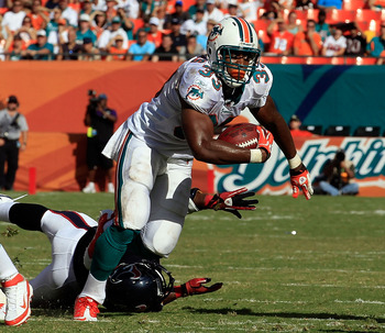 MIAMI GARDENS, FL - SEPTEMBER 18:   Daniel Thomas #33 of the Miami Dolphins rushes for yardage during a game agaisnt the Houston Texans  at Sun Life Stadium on September 18, 2011 in Miami Gardens, Florida.  (Photo by Sam Greenwood/Getty Images)