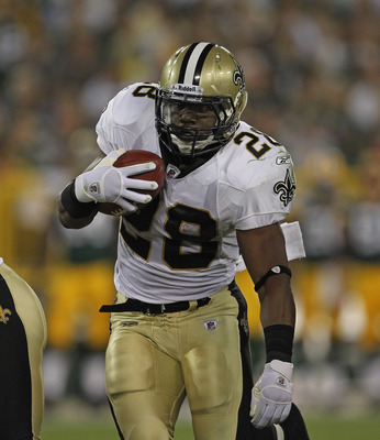 GREEN BAY, WI - SEPTEMBER 08: Mark Ingram #28 of the New Orleans Saints runs against the Green Bay Packers during the NFL opening season game at Lambeau Field on September 8, 2011 in Green Bay, Wisconsin. The Packers defeated the Saints 42-34. (Photo by J