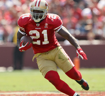 SAN FRANCISCO, CA - SEPTEMBER 11:  Frank Gore #21 of the San Francisco 49ers in action during their season opener at Candlestick Park against the Seattle Seahawks on September 11, 2011 in San Francisco, California.  (Photo by Ezra Shaw/Getty Images)