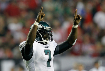 ATLANTA, GA - SEPTEMBER 18:  Michael Vick #7 of the Philadelphia Eagles reacts after a touchdown against the Atlanta Falcons at Georgia Dome on September 18, 2011 in Atlanta, Georgia.  (Photo by Kevin C. Cox/Getty Images)