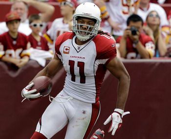 LANDOVER, MD - SEPTEMBER 18:  Wide receiver Larry Fitzgerald #11 of the Arizona Cardinals reacts after scoring a touchdown against the Washington Redskins during the second half at FedExField on September 18, 2011 in Landover, Maryland. Washington defeate