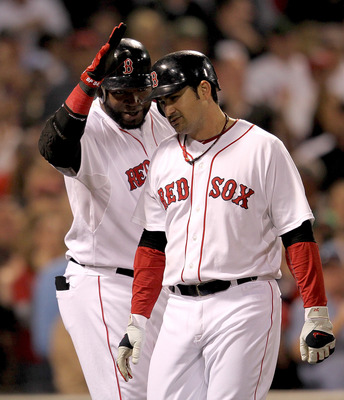 BOSTON, MA - SEPTEMBER 20:  Adrian Gonzalez #28 of the Boston Red Sox celebrates his two-run home run with David Ortiz #34 of the Boston Red Sox in the third inning against the Baltimore Orioles at Fenway Park September 20, 2011 in Boston, Massachusetts.