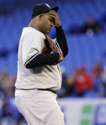 TORONTO, CANADA - SEPTEMBER 16:  CC Sabathia #52 of the New York Yankees reacts to allowing a run against the Toronto Blue Jays at the Rogers Centre September 16, 2011 in Toronto, Ontario, Canada. (Photo by Abelimages/Getty Images)