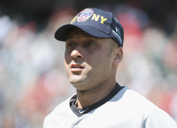 ANAHEIM, CA - SEPTEMBER 11:  Derek Jeter #2 of the New York Yankees wears a FDNY baseball cap before a pre-game ceremony recognizing the 10th anniversary of the September 11th attacks at Angel Stadium of Anaheim on September 11, 2011 in Anaheim, Californi