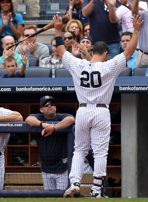 NEW YORK, NY - SEPTEMBER 25:  Jorge Posada #20 of the New York Yankees waves to the crowd after hitting a 2 RBI home run in the third inning against the Boston Red Sox on September 25, 2011 at Yankee Stadium in the Bronx borough of New York City.  (Photo