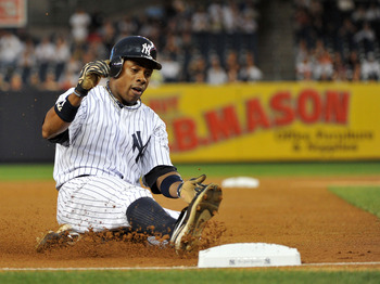 NEW YORK, NY - SEPTEMBER 25: Curtis Granderson #14 of the New York Yankees slides into third base in the bottom of the first inning against the Boston Red Sox on September 25, 2011 at Yankee Stadium in the Bronx borough of New York City. (Photo by Christo