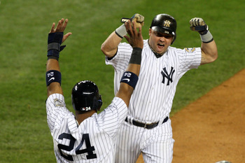 NEW YORK - OCTOBER 25:  Nick Swisher #33 of the New York Yankees (R) celebrates with Robinson Cano #24 during the game against the Los Angeles Angels of Anaheim in Game Six of the ALCS during the 2009 MLB Playoffs at Yankee Stadium on October 25, 2009 in