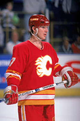 INGLEWOOD, CA - 1990:  Forward Joe Mullen #7 of the Calgary Flames skates against the Los Angeles Kings during a 1989-90 NHL Playoff Game at the Great Western Forum in Inglewood, California.  (Photo by Mike Powell/Getty Images)