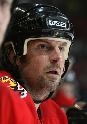 CALGARY, CANADA - JANUARY 19:  Tony Amonte #10 of the Calgary Flames looks on from the bench during their game against the Montreal Canadiens on January 19, 2006 at the Pengrowth Saddledome in Calgary, Alberta, Canada. The Flames defeated the Canadiens 3-