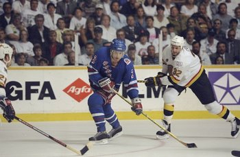 Jun 1994: Brian Leetch #2 of the New York Rangers tries to get the puck during the Stanley Cup Finals against the Vancover Canucks at the Pacific Coliseum in Vancover, Canada. Mandatory Credit: Mike Powell  /Allsport