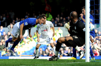 LIVERPOOL, ENGLAND - SEPTEMBER 17:  Phil Jagielka of Everton scores his team's first goal past Ali Al Habsi of Wigan Athletic  during the Barclays Premier League match between Everton and Wigan Athletic at Goodison Park on September 17, 2011 in Liverpool,