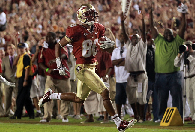 TALLAHASSEE, FL - SEPTEMBER 17:  Rashad Greene #80 of the Florida State Seminoles makes a touchdown pass reception against the Oklahoma Sooners in the fourth quarter at Doak Campbell Stadium on September 17, 2011 in Tallahassee, Florida.  (Photo by Ronald