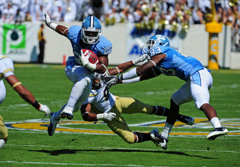 ATLANTA - SEPTEMBER 24: Giovani Bernard #26 of the North Carolina Tar Heels carries the ball with a block by Dwight Jones #83 against Louis Young #8 of the Georgia Tech Yellow Jackets at Bobby Dodd Field on September 24, 2011 in Atlanta, Georgia. Photo by