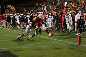 COLLEGE PARK, MD - SEPTEMBER 05: Running back Lamar Miller #6 of the Miami Hurricanes is brought down by a Maryland Terrapins defender just shy of the endzone during the second half at Byrd Stadium on September 5, 2011 in College Park, Maryland. Maryland