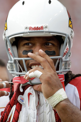 LANDOVER, MD - SEPTEMBER 18: Wide receiver  Larry Fitzgerald #11 of the Arizona Cardinals waits to take the field during the second half against the Washington Redskins at FedExField on September 18, 2011 in Landover, Maryland. Washington defeated the Ari
