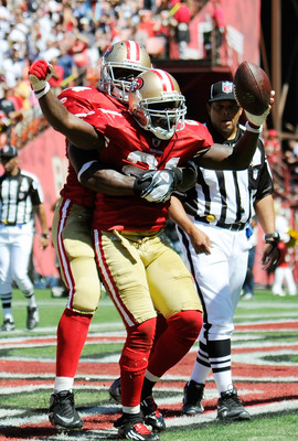 SAN FRANCISCO, CA - SEPTEMBER 18: Frank Gore #21 of the San Francisco 49ers celebrates with Joe Staley #74 after scoring a touchdown against the Dallas Cowboys in the second quarter during an NFL football game at Candlestick Park on September 18, 2011 in