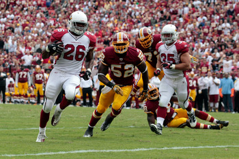 LANDOVER, MD - SEPTEMBER 18: Running back  Beanie Wells #26 of the Arizona Cardinals rushes for a touchdown in front of defender  Rocky McIntosh #52 of the Washington Redskins during the second half at FedExField on September 18, 2011 in Landover, Marylan