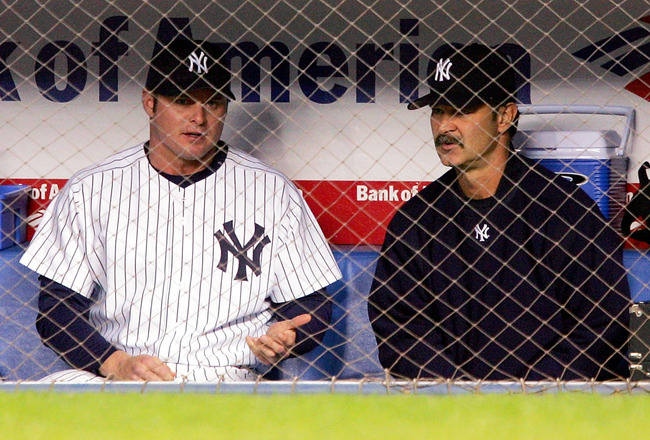 BRONX, NY - MAY 10:  Jason Giambi #25 of the New York Yankees speaks with the Yankees Hitting Coach Don Mattingly in the dugout during the Yankees game against the Seattle Mariners at Yankee Stadium on May 10, 2005 in Bronx, New York.   (Photo by Ezra Sha