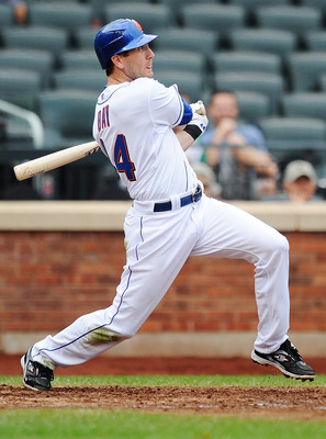 NEW YORK, NY - SEPTEMBER 15:  Jason Bay #44 of the New York Mets hits a RBI double during the sixth inning against the Washington Nationals at Citi Field on September 15, 2011 in the Flushing neighborhood of the Queens borough of New York City.  (Photo by