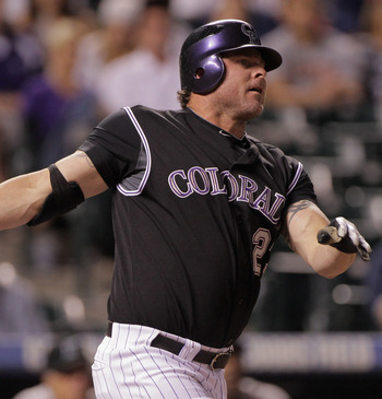 DENVER, CO - AUGUST 16:  Jason Giambi #23 of the Colorado Rockies watches his two run homerun to right field off of closer Leo Nunez #46 of the Florida Marlins in the ninth inning at Coors Field on August 16, 2011 in Denver, Colorado. The Marlins defeated