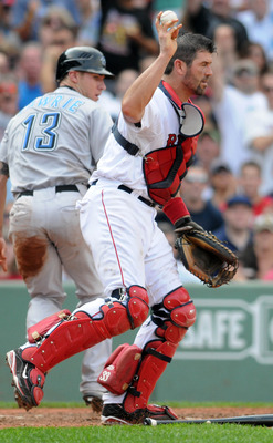 BOSTON, MA - SEPTEMBER 14: Catcher Jason Varitek #33 of the Boston Red Sox holds onto the ball after a collision at home plate with Brett Lawrie #13 of the Toronto Blue Jays at Fenway Park on September 14, 2011 in Boston, Massachusetts. The Blue Jays won