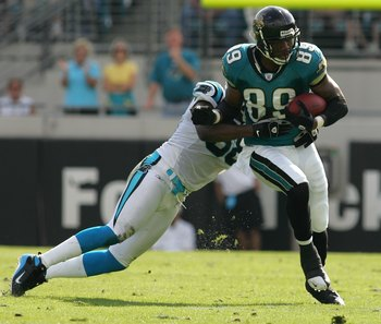 JACKSONVILLE, FL - DECEMBER 09:  Marcedes Lewis #89 of the Jacksonville Jaguars breaks a tackle in a game against the Carolina Panthers at Jacksonville Municipal Stadium on December 9, 2007 in Jacksonville, Florida.  The Jaguars beat the Panthers 37-6.  (