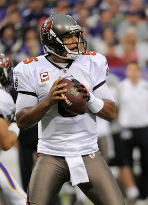 MINNEAPOLIS, MN - SEPTEMBER 18: Josh Freeman #5 of the Tampa Bay Buccaneers carries the ball against the Minnesota Vikings on September 18, 2011 at the Hubert H. Humphrey Metrodome in Minneapolis, Minnesota. (Photo by Hannah Foslien/Getty Images)