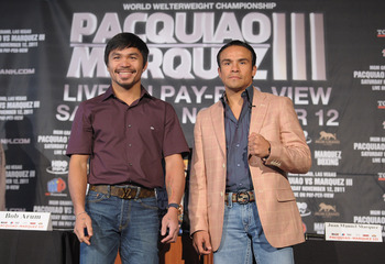 NEW YORK, NY - SEPTEMBER 06:  Professional Boxers Manny Pacquiao (L) and Juan Manuel Marquez attend the press conference for their World Welterweight Championship Fight at The Lighthouse at Chelsea Piers on September 6, 2011 in New York City.  (Photo by M