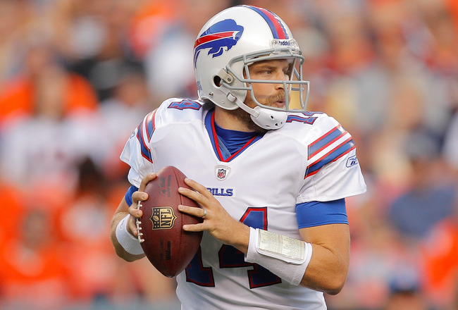 DENVER, CO - AUGUST 20:  Quarterback Ryan Fitzpatrick #14 of the Buffalo Bills drops back to pass against the Denver Broncos during the first half at Sports Authority Field at Mile High on August 20, 2011 in Denver, Colorado. (Photo by Justin Edmonds/Gett