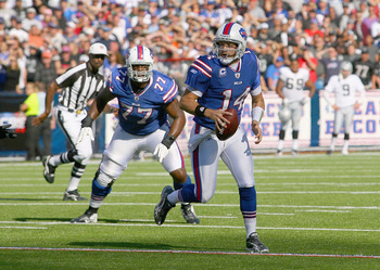ORCHARD PARK, NY - SEPTEMBER 18: Ryan Fitzpatrick #14 of the Buffalo Bills runs late in the fourth quarter against the Oakland Raiders at Ralph Wilson Stadium on September 18, 2011 in Orchard Park, New York. Buffalo won 38-35.  (Photo by Rick Stewart/Gett