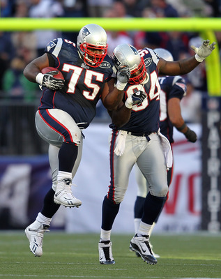FOXBORO, MA -  SEPTEMBER 18:  Vince Wilfork #75 of the New England Patriots celebrates his interception and run with teammate Deion Branch #84 of the New England Patriots in the first half against the San Diego Chargers in the first half at Gillette Stadi