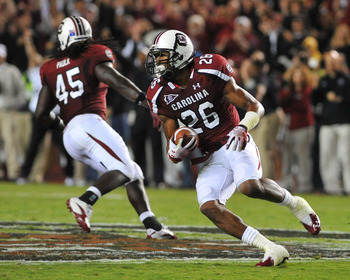 COLUMBIA, SC - SEPTEMBER 17:  Defensive back Antonio Allen #26 of the South Carolina Gamecocks intercepts a fourth-quarter pass against the Navy Midshipmen September 17, 2011 at Williams-Brice Stadium in Columbia, South Carolina.  (Photo by Al Messerschmi