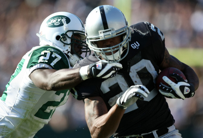 OAKLAND, CA - OCTOBER 19:  Darren McFadden #20 of the Oakland Raiders runs against Abram Elam #27 of the New York Jets during an NFL game on October 19, 2008 at the Oakland-Alameda County Coliseum in Oakland, California.  (Photo by Jed Jacobsohn/Getty Ima