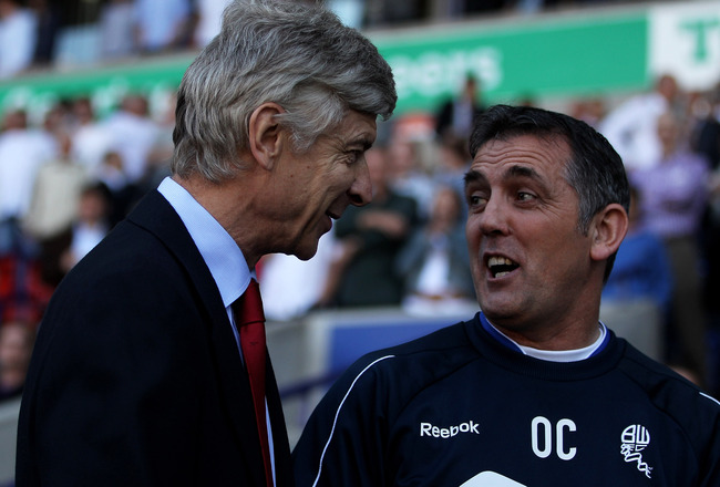 BOLTON, ENGLAND - APRIL 24:  Arsenal Manager Arsene Wenger chats with Bolton Wanderers Manager Owen Coyle (R) prior to the Barclays Premier League match between Bolton Wanderers and Arsenal at the Reebok Stadium on April 24, 2011 in Bolton, England.  (Pho
