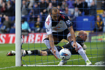 BOLTON, ENGLAND - SEPTEMBER 17:  Martin Petrov of Bolton Wanderers runs into the goal after scoringfrom the penalty spot to collect the ball  during the Barclays Premier League match between Bolton Wanderers and Norwich City at Reebok Stadium on September