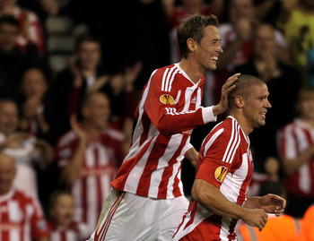 STOKE, ENGLAND - SEPTEMBER 29:  Peter Crouch of Stoke City congratulates Jonathan Walters (R) after he scored his team's second goal during the UEFA Europa League Group E match between Stoke City and Besiktas JK at the Britannia Stadium on September 29, 2