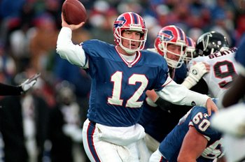 12 Nov 1995: Jim Kelly #12 of the Buffalo Bills gets ready to pass the ball during the game against the Atlanta Falcons at the Rich Stadium in Orchard Park, New York. The Bills defeated the Falcons 23-17.