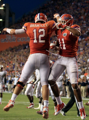 GAINESVILLE, FL - SEPTEMBER 03:  Quarterback John Brantley #12 and Jordan Reed #11 of the University of Florida Gators celebrate following a touchdown during a game against the Florida Atlantic University Owls at Ben Hill Griffin Stadium on September 3, 2
