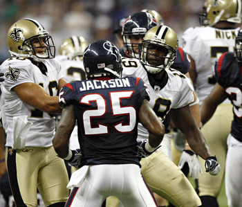 HOUSTON - AUGUST 20:  Cornerback Kareem Jackson #25 of the Houston Texans and Devery Henderson #19 of the New Orleans Saints get into an altercation at Reliant Stadium on August 20, 2011 in Houston, Texas.  (Photo by Bob Levey/Getty Images)