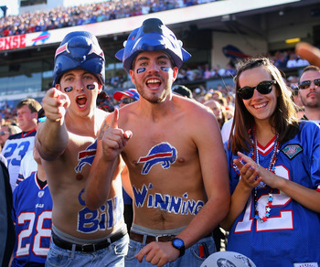 ORCHARD PARK, NY - SEPTEMBER 18: Fans of the Buffalo Bills celebrate after the Bills scored the game winning touchdown against the Oakland Raiders at Ralph Wilson Stadium on September 18, 2011 in Orchard Park, New York. Buffalo won 38-35.  (Photo by Rick