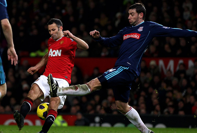 MANCHESTER, ENGLAND - JANUARY 04:  Rory Delap of Stoke City challenges Ryan Giggs of Manchester United during the Barclays Premier League match between Manchester United and Stoke City at Old Trafford on January 4, 2011 in Manchester, England. (Photo by C