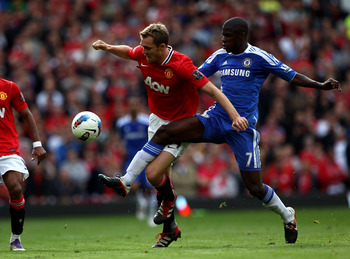 MANCHESTER, ENGLAND - SEPTEMBER 18:  Darren Fletcher of Manchester United tangles with Ramires of Chelsea during the Barclays Premier League match between Manchester United and Chelsea at Old Trafford on September 18, 2011 in Manchester, England. (Photo b