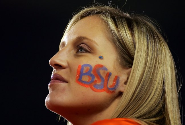 GLENDALE, AZ - JANUARY 1:  A Boise State Broncos fan looks on as she watches the Tostito's Fiesta Bowl against the Boise State Broncos at University of Phoenix Stadium January 1, 2007 in Glendale, Arizona.  (Photo by Jonathan Ferrey/Getty Images)